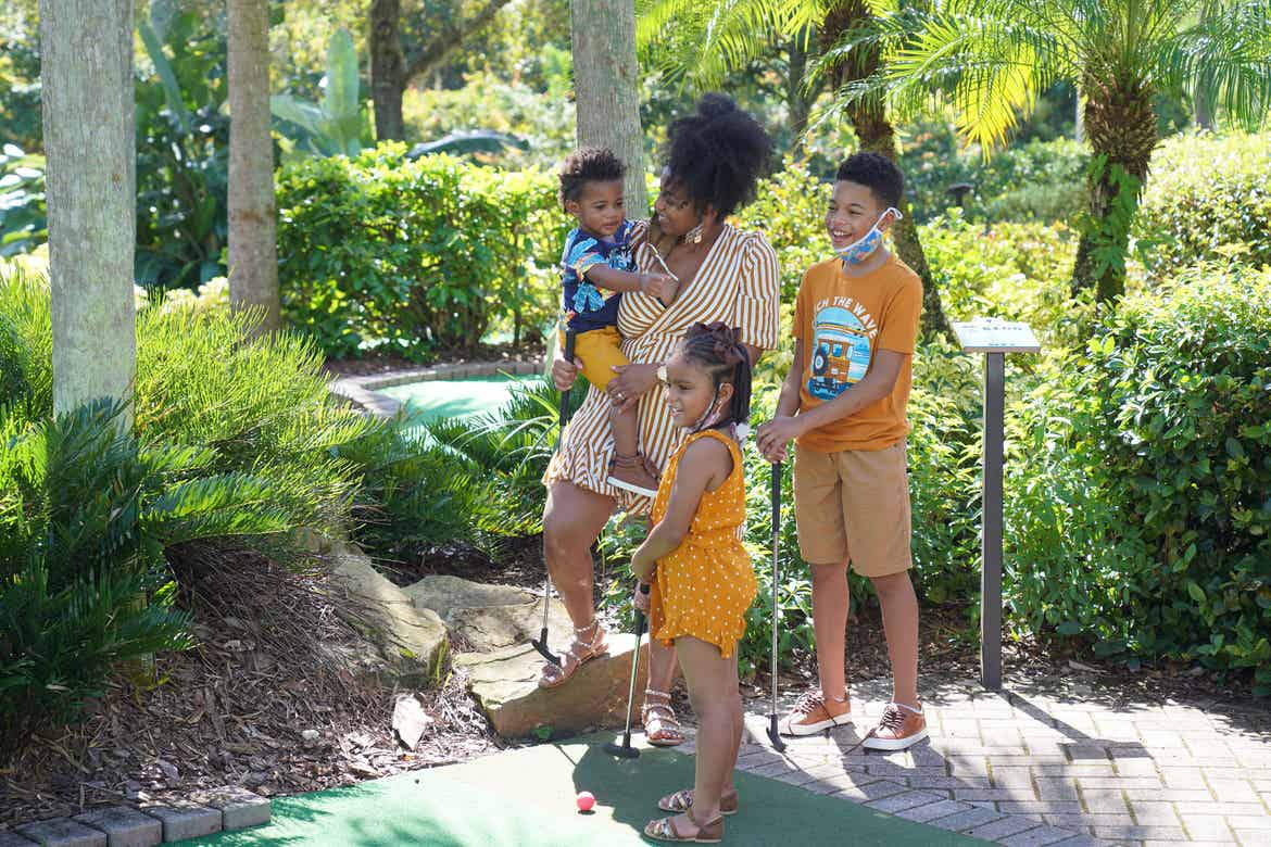 Featured Contributor, Tina Meeks, stands with her daughter and sons on the minature golf course of our Orange Lake resort in Orlando, Florida.