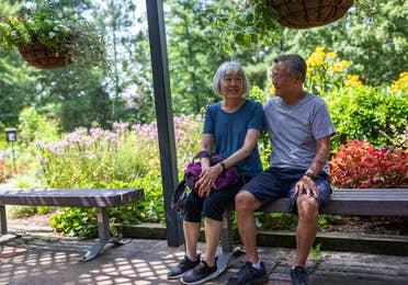 Couple sitting on bench at Tyler Rose Garden near Villages Resort in Flint, Texas.
