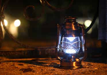 Lit lantern at night.