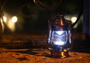 Lit lantern at night.