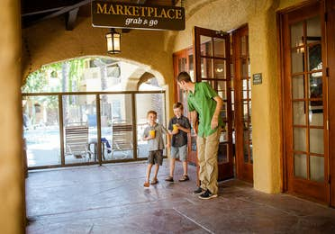 Adult and two children leaving the Marketplace at Scottsdale Resort in Scottsdale, Arizona.