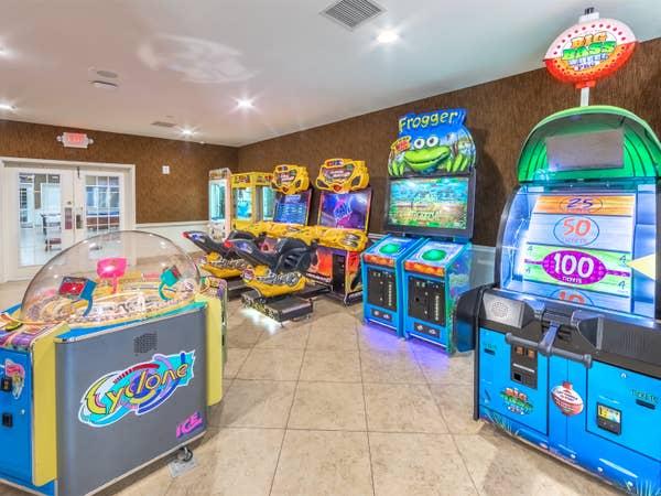 Game room with arcade-style games at Orlando Breeze Resort near Orlando, Florida.
