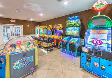 Game room with arcade-style games at Orlando Breeze Resort near Orlando, Florida.