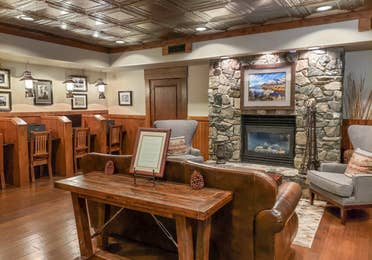 Lobby with stone fireplace and individual computers for guests to use at David Walley's Resort in Genoa, Nevada