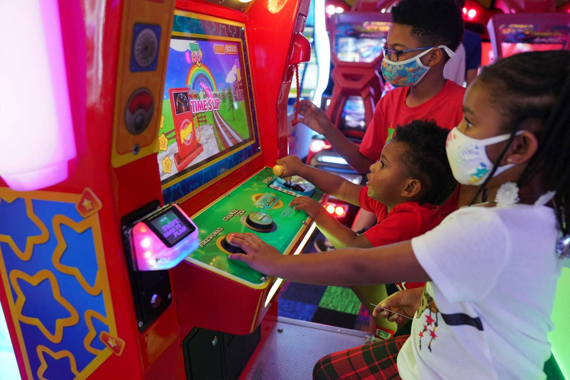 Featured Contributor, Tina Meeks' children play in the arcade of our Orange Lake resort in Orlando, Florida.