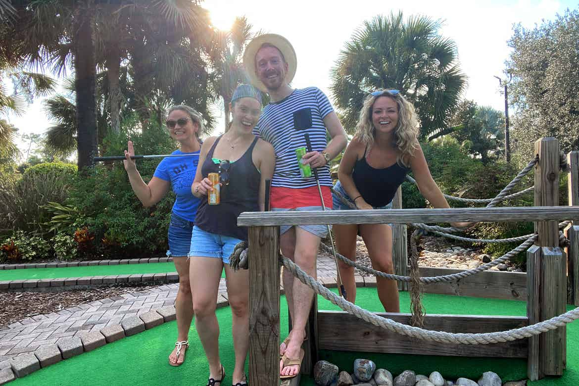 Featured Contributor, Angie Orth (far-right), and her friends hold their putters outside on our mini-golf course.