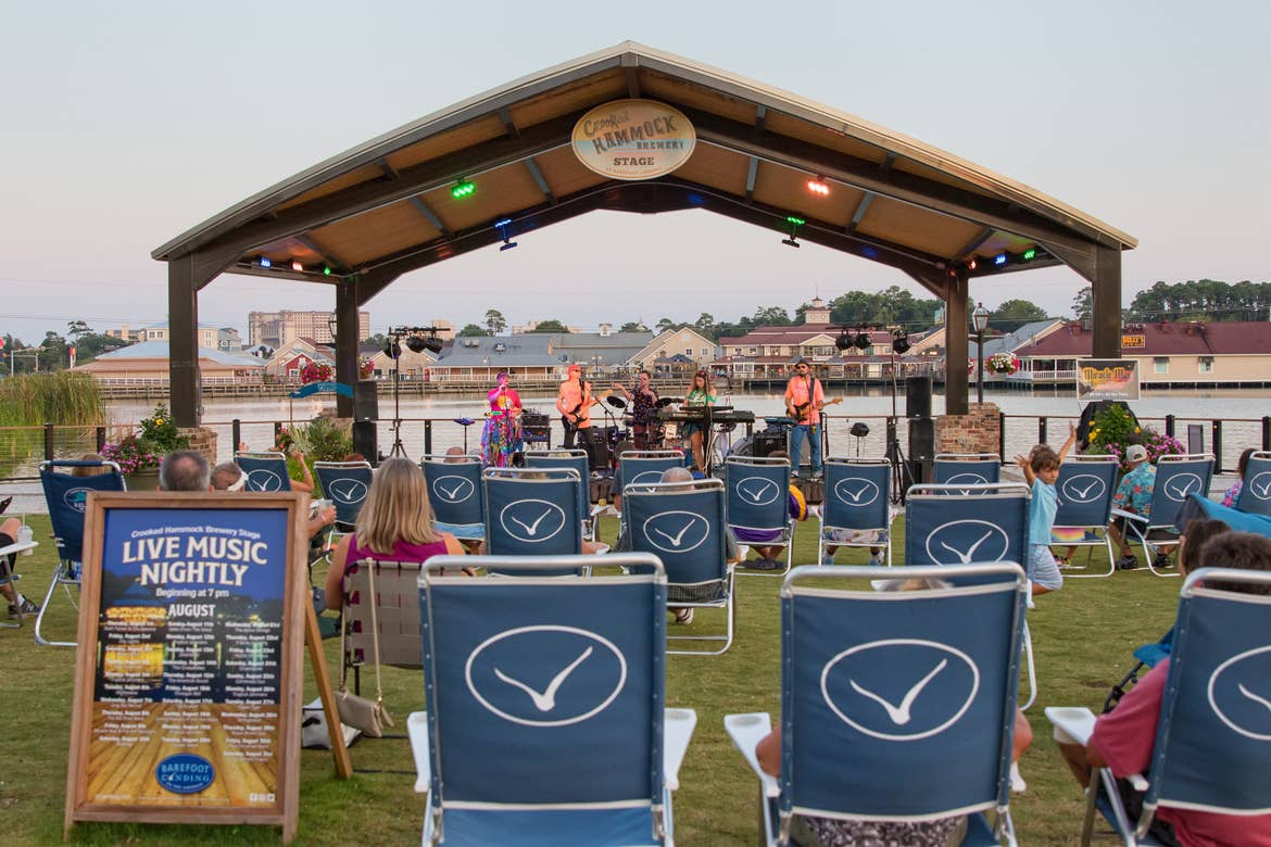 Guests enjoy outdoor entertainment at Barefoot Landing in Myrtle Beach, SC.