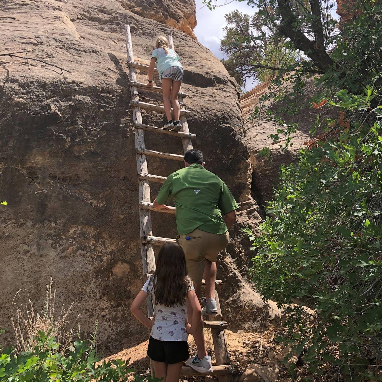 Chris' husband and daughters climb the ladder at Canyonlands National Park.