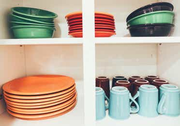 Colorful dishes in cabinet in a villa in River Island at Orange Lake Resort near Orlando, Florida