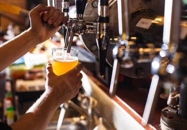 Image of a person pouring tap beer near Lake Geneva Resort, Lake Geneva, WI.