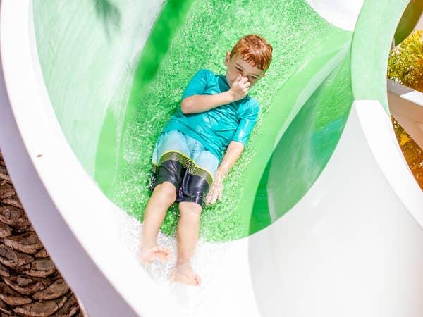Child going down waterslide at Scottsdale Resort in Arizona.