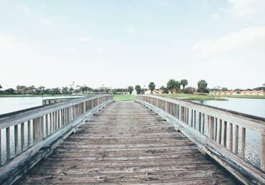 Bridge over lake leading to golf course in West Village at Orange Lake Resort near Orlando, Florida
