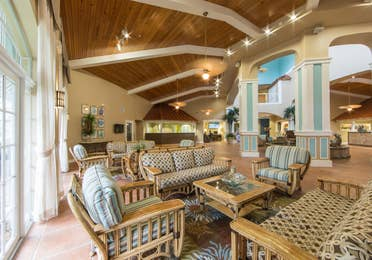 Comfortable seating and coastal decor in the lobby of Cape Canaveral Beach Resort.