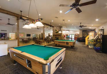 Indoor arcade area with a pool table at the Holiday Hills Resort in Branson, Missouri.