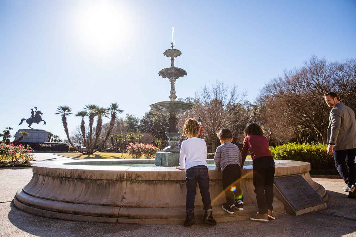 Featured Contributor, Sally Butan of @butanclan's children,  Alissa (left), Alston (middle) and Alex (right) stand near the fountain at Jackson Square of New Orleans, Louisiana.