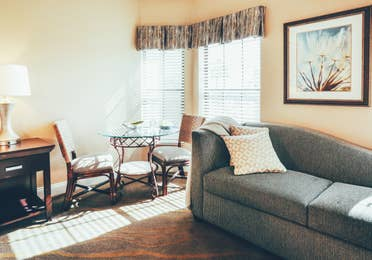 Couch and small dining area in a three bedroom villa in West Village at Orange Lake Resort near Orlando, FL