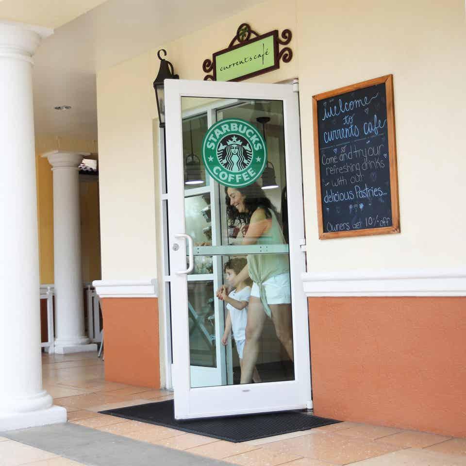 Adult and child leaving Currents Cafe at Orange Lake Resort near Orlando, Florida.