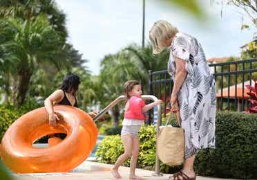 Family exiting lazy river at Orange Lake Resort near Orlando, Florida