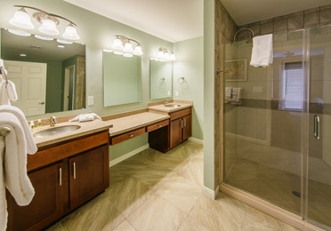 Master Bathroom with double sinks and a large shower in a two-bedroom ambassador villa at the Hill Country Resort in Canyon Lake, Texas.
