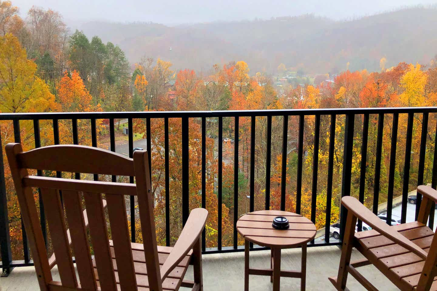 Two rocking chairs face towards fall foliage on the patio of our villa at Smoky Mountain Resort in Gatlinburg, Tennessee.