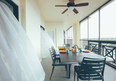 Furnished balcony with table and six chairs in a villa in River Island at Orange Lake Resort near Orlando, Florida