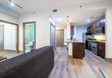 Two bedroom villa with view of full kitchen, bathroom and couch at New Orleans Resort in Louisiana.
