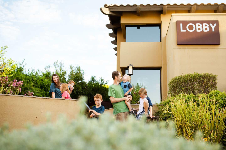 The Averett family walks along the Lobby entrance of our Scottsdale Resort.