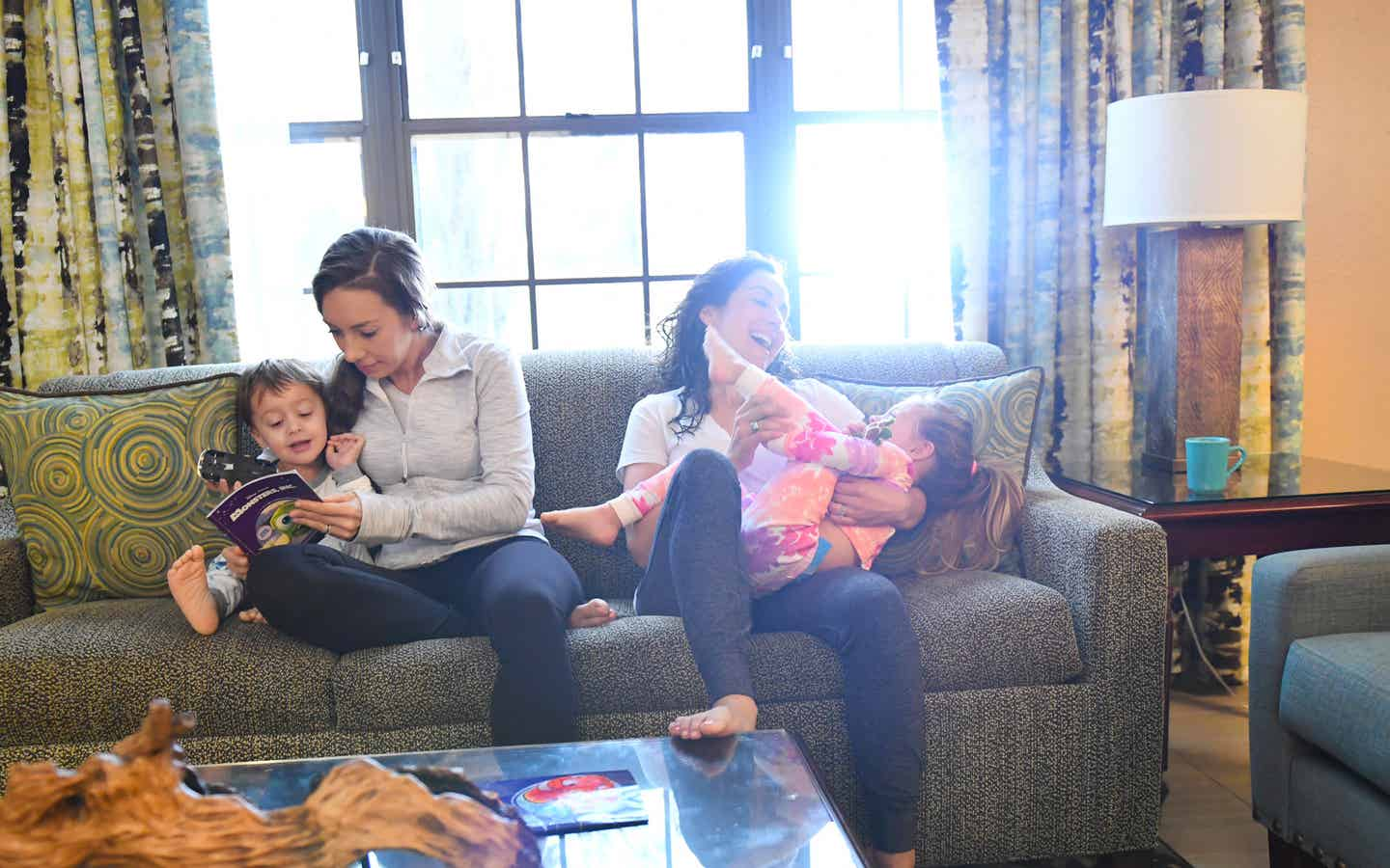Family reading and laughing on a sofa
