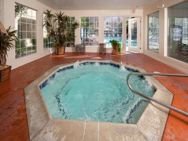 Indoor hot tub with view of outdoor pool at Desert Club Resort in Las Vegas, Nevada.