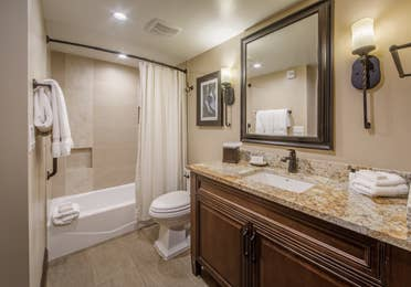 Full bathroom with shower/tub combination and sink with mirror in a signature one-bedroom villa at Scottsdale Resort
