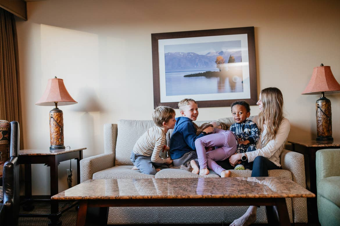 Andrea Rassmussen and her children snuggle up on the couch