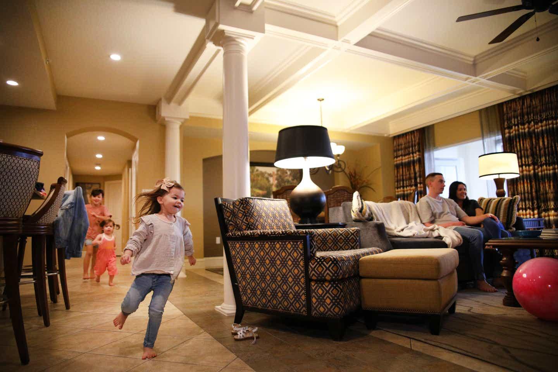 Mia St Clair's kids running around in their villa at Orange Lake Resort
