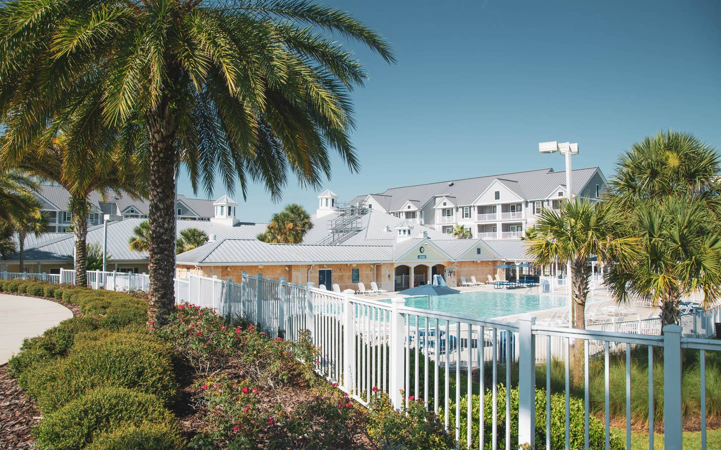 View of outdoor pool and property building at Orlando Breeze Resort in Florida.