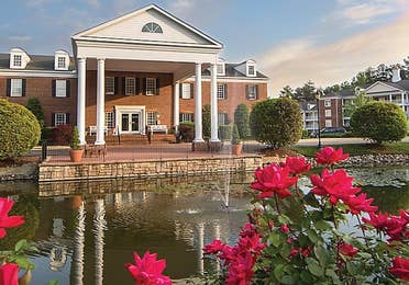 A scenic view of Williamsburg Resort through the flowers