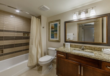 Bathroom with shower/tub combination and sink with mirror in a two-bedroom villa at Scottsdale Resort
