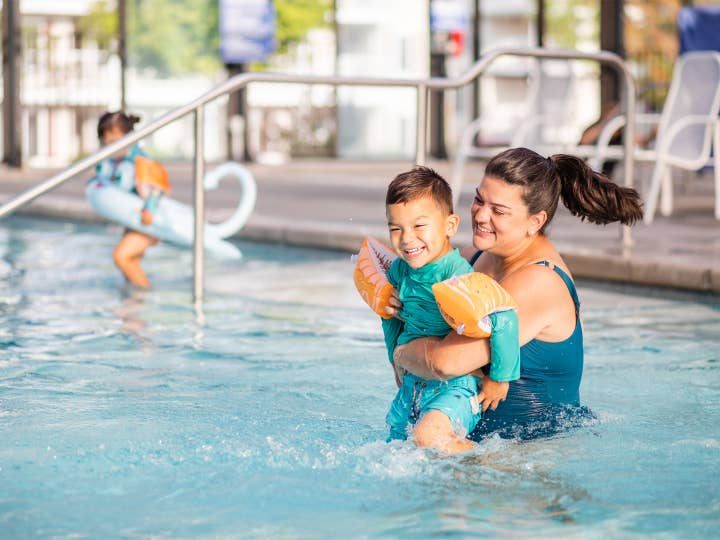 Adult and child playing in pool at Holiday Hills Resort in Branson, Missouri.