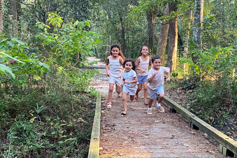 Brendas kids run on the hiking trail through a lush landscape.