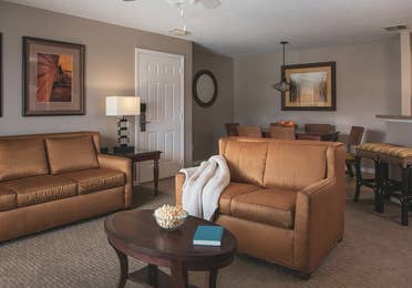Living room with couch and loveseat in a three-bedroom villa at Orlando Breeze Resort.