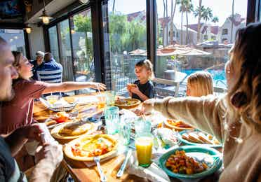 Family eating breakfast at Gold Mine Bar & Grill at Desert Club Resort in Las Vegas, Nevada.
