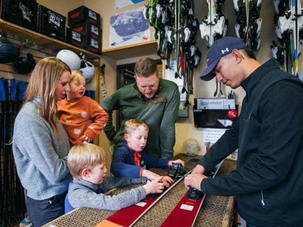 Family at Ski Shop at Tahoe Ridge Resort in Stateline, NV.