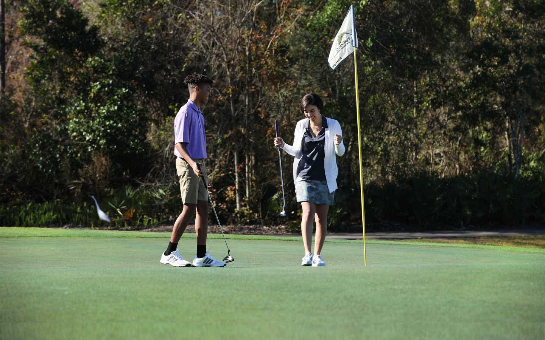 Two golfers at The Legends at Orange Lake Resort near Orlando, Florida.
