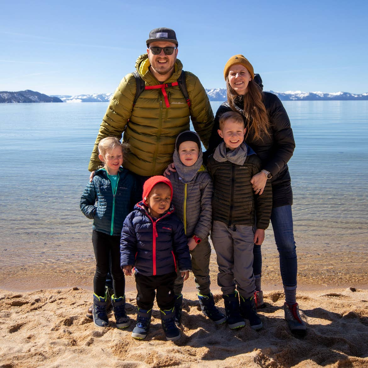 Featured Contributor, Andrea Rassmussen (back-right), stands with her family on the sands at Sand Harbor in Nevada State Park.