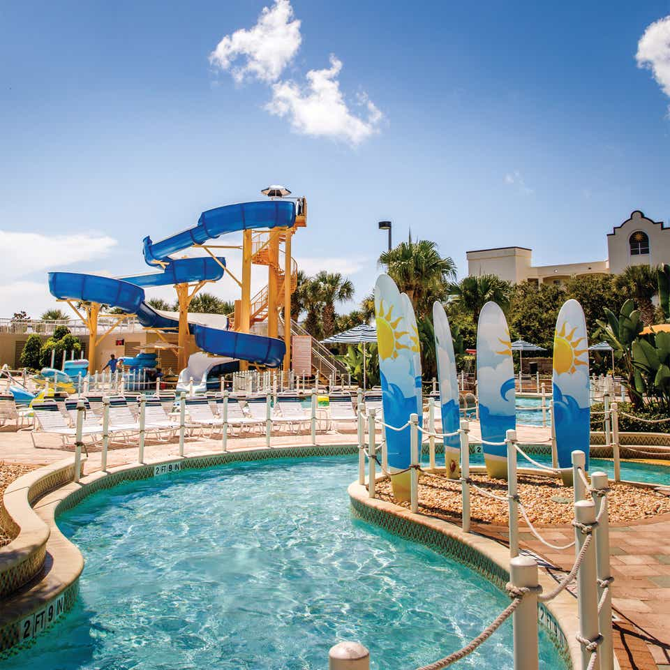 Lazy river with waterslide in background at Cape Canaveral Beach Resort.