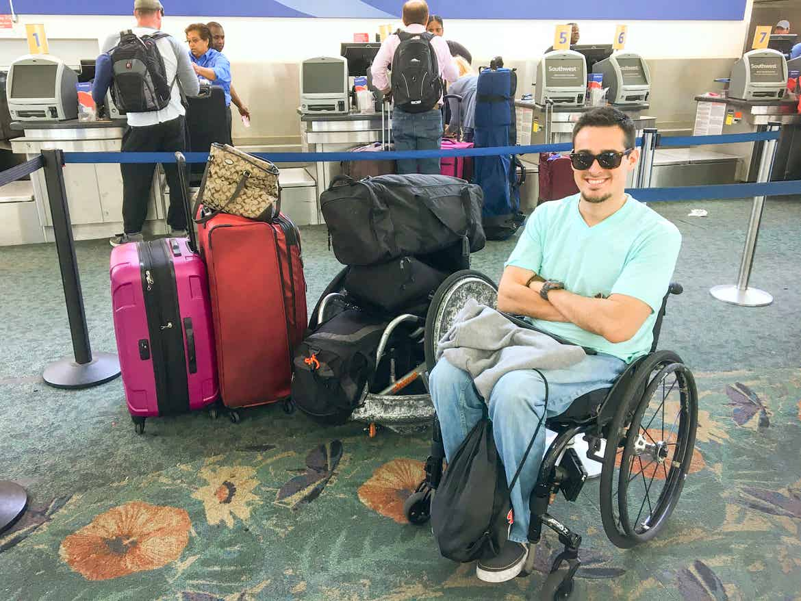 Danny at the airport next to all his luggage
