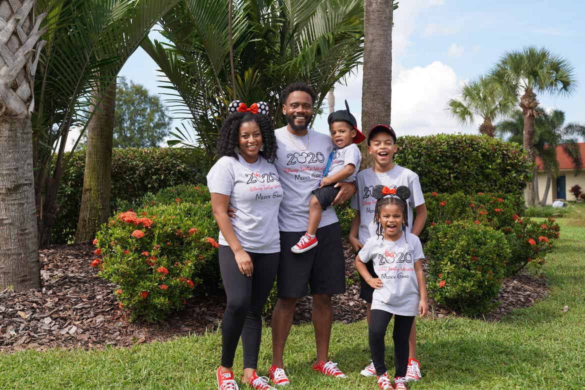 Featured Contributor, Tina Meeks, stands with her husband, daughter and sons in matching Disney shirts and accessories at our Orange Lake resort in Orlando, Florida.
