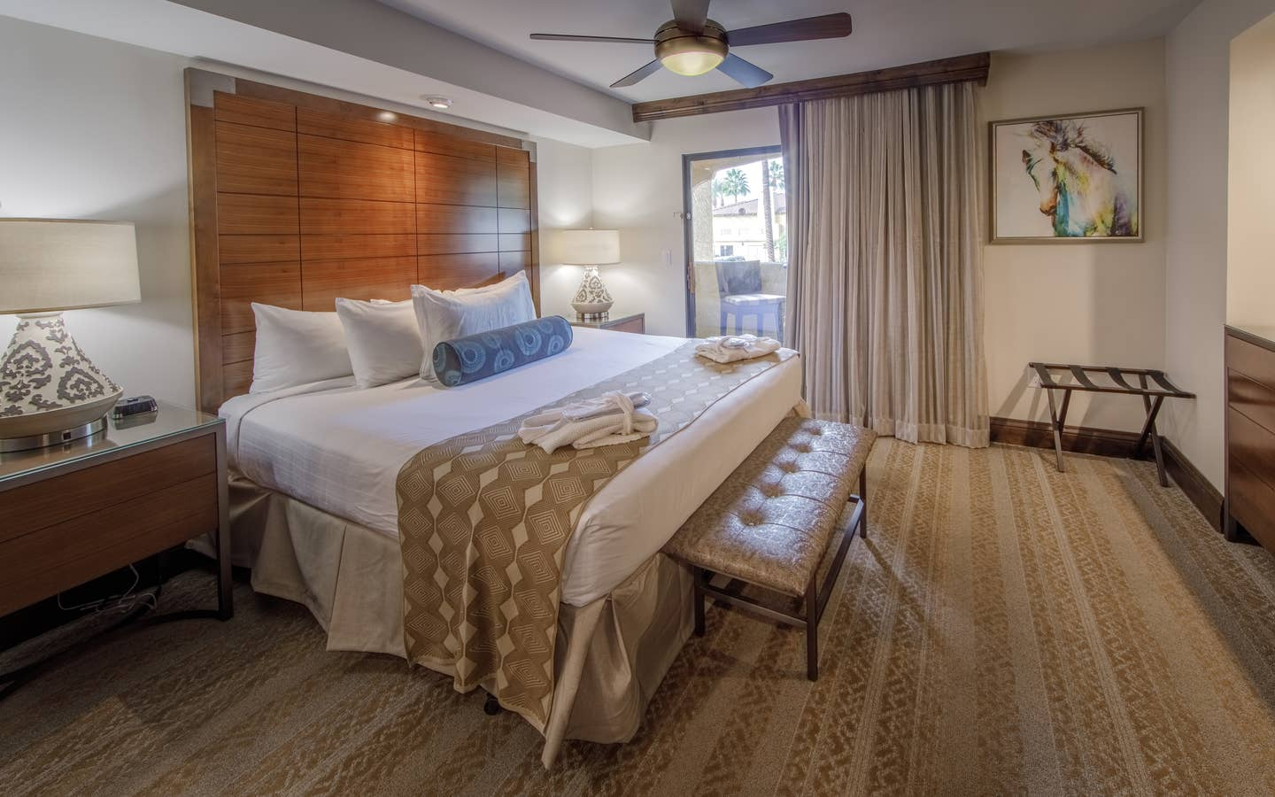 Bedroom with king bed and attached balcony in a signature one-bedroom villa at Scottsdale Resort