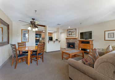 Living room and dining area in a Crest Pointe two-bedroom villa at Tahoe Ridge Resort