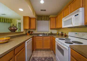 Kitchen and amenities in a two-bedroom presidential villa at the Holiday Hills Resort in Branson Missouri.