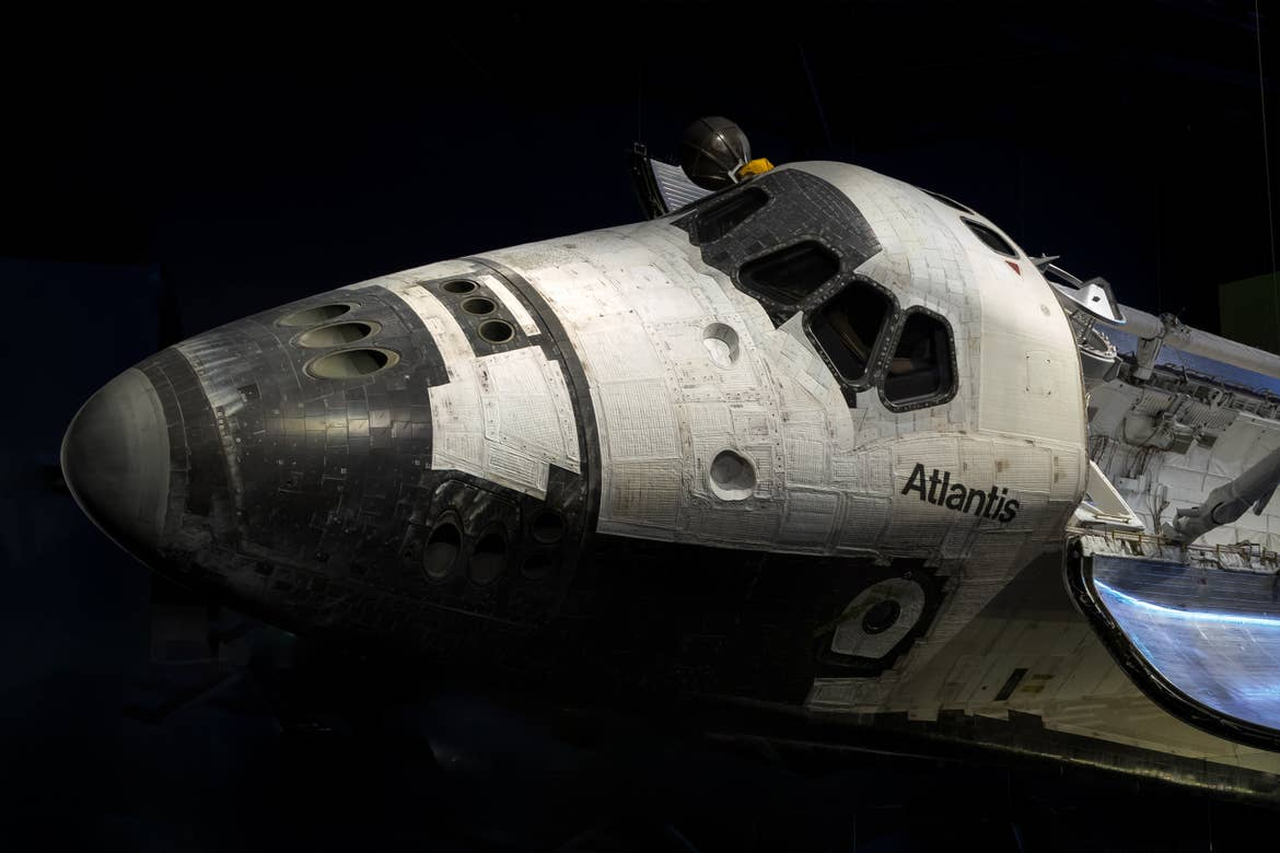 The Atlantis Shuttle hangs in an exhibit hall at the Kennedy Space Center.