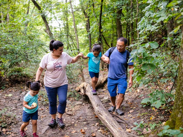 Family of four hiking at Table Rock Lake near Holiday Hills Resort.